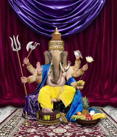 Picture of Ganesh the Hindu God of success also named Ganapat. This photo shows all of Ganesha's symbolic items including the mouse.