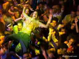 stock photo of a man being passed overhead in the crowd at a disco