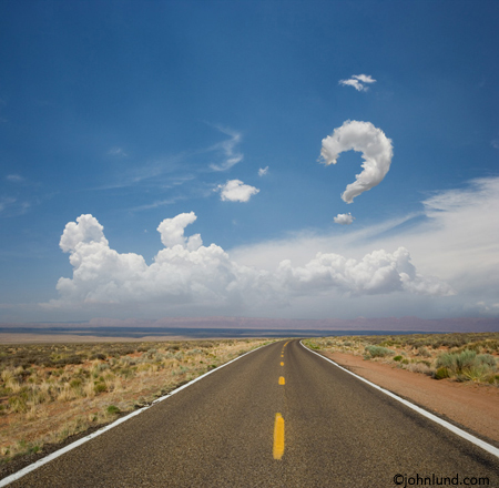 long road leading into the distance with a question mark cloud in the sky