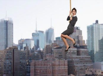 This background shot is of a woman dangling at the end of her rope high above the city streets