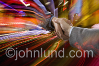Pictures of handshakes.  This handshake picture has a background of colorful streaks of light.