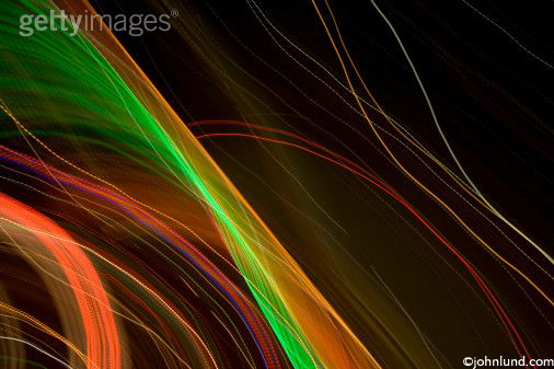 Beautiful image of bending undulating waving lights tracing intricate patterns on the black background.