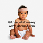 A baby in diapers wearing an ace bandage around his forehead.  He also has a band aid on his left leg.  The adorable baby is looking at the camera. Funny picture of a baby with a bandage.