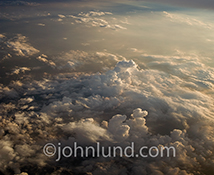 A high-altitude downward looking view of a cloudscape in the late afternoon creates a great stock photo background for a wide range of subjects.