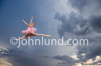 A ballerina Leaps Through the Air in This Stock Photo and fine art picture about Freedom, Vitality, Skill and Dedication.