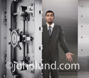 A bank executive, wearing a horrified expression, stands in an empty bank vault in a stock photo dealing with financial challenges.
