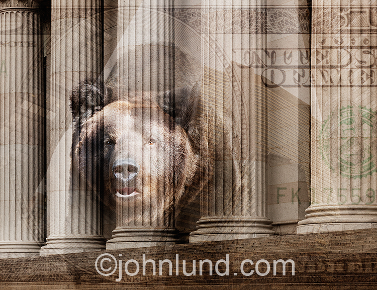 A bear market is indicated by this image of a bear superimposed over the columns of a building that is representative of Wall Street.