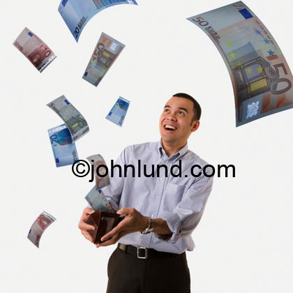A man is holding his wallet open with his hands and looking up at all the money streaming out of his wallet and filling the air with money. Euro bank notes are streaming from his billfold.