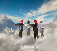 Four business people with blindfolds on follow each other through a cloud bank in a stock photo about leadership and associated issues in cloud computing.