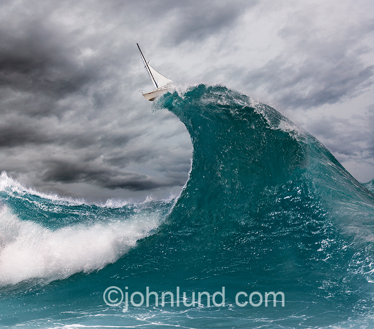 A sailboat sits atop the crest of a giant ocean wave in an image about risk, danger, courage, audacity and exploring. This is a stock photo about taking on challenges and going for it.