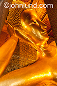 Stock image of a huge, golden buddha statue in South East Asia.