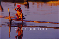 Picture of river life in Myanmar, a boy pours water over himself as he bathes in the Irrawady river. This young boy was bathing at the
