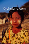 Stock photo of a young Burmese girl. The white paint on her face is used both to protect from the sun and as a beautifying makeup worn by virtually all the women and girls of Myanmar.