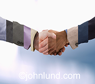 A business handshake is shown in slices of multiple handshakes combined to illustrate the concepts of diversity, agreement and teamwork.