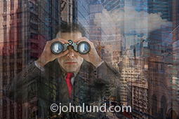 A business man peers through high powered binoculars search an urban environment for investment opportunities, new markets and the way forward in a concept stock photo.