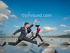 The challenge of business is dramatically demonstrated in this stock photo of three business people leaping from rock to rock across a body of water...an image that uses humor to attract the attention of viewers.