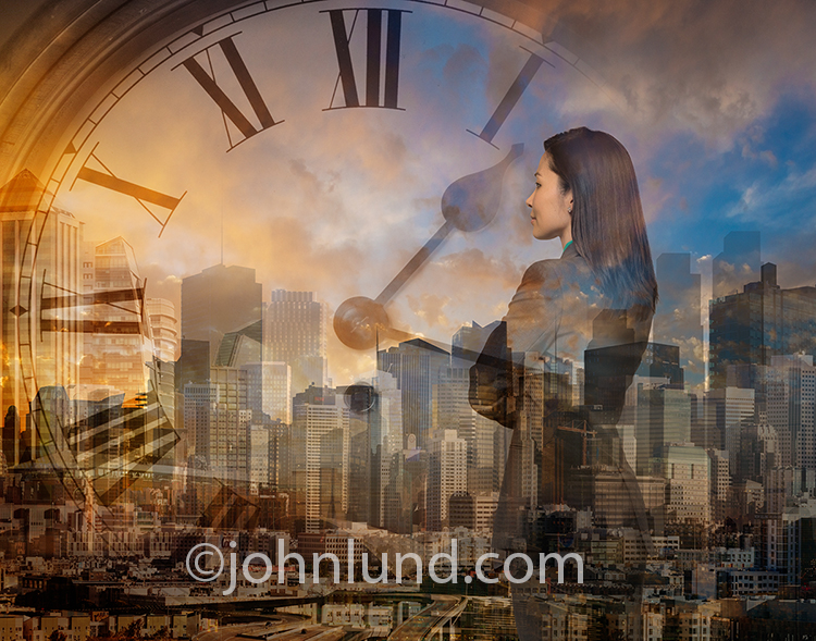 A businesswoman is superimposed over an urban skyline and clock in a stock photo about contemplation, leadership, and deadlines.