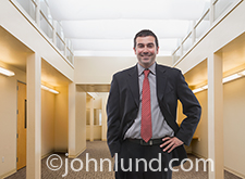 Portrait of a happy, smiling and successful businessman in a relaxed pose photographed in an office setting.