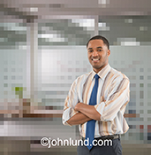 A businessman stands in a digitized virtual office in a concept stock photo about business in the digital age, cloud computing, and networking.