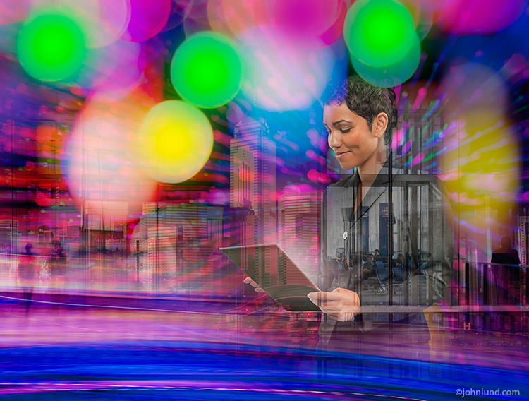 A business woman is seen in a complex urban business environment in a stock photo about fast paced business in the Internet age.