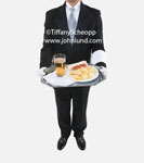 Stock photo of a butller holding a tray with food. On the silver serving tray is a hotdog, chips, and a big glass of beer.  Butler is wearing a tux, white gloves, and has a towel over his arm.  Luxury lifestyle photos.