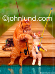 Funny animal stock picture of father and son (cat and kitten) fishing together while sitting with their poles on the end of a wooden pier. Funny pictures of cats.