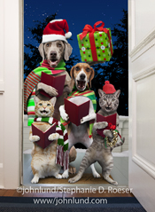 Two dogs and two cats sing Christmas carols and offer a gift in this funny holiday pet picture featuring dogs and cats wearing xmas scarves, a Santa Hat, and some jingle bells.