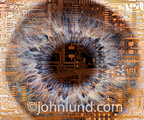 In this extreme close up stock photo of a human eye, the eye is over layed with computer circuitry illustrating concepts of bio engineering, medical technology and artificial intelligence.