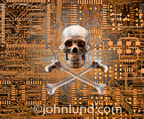 Computer crime and network security are just two of the digital security issues powerfully illustrated by this stock photo of a skull and crossbones embedded in computer circuitry.