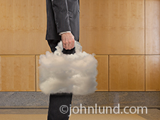 A businessman with a cloud in hand, a cloud taking the form of a briefcase, is a metaphor for the fact that when you have