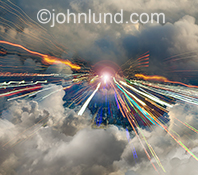 Streaks of vibrating colored lights zoom towards the viewer through a high altutude cloud bank over a twilight city in a stock image about cloud computing technology, speed, bandwidth and related concepts.