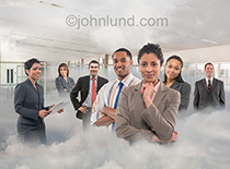 Teamwork in the cloud is the theme of this photo showing a team of executives standing in clouds in an office environment.