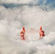 A crystal ball and pair of hands float in a sea of clouds in an image that speaks of the future, of future communications technology and of vision.