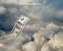 The perils and dangers of cloud computing are illustrated in the humorous stock photo depicting a hundred dollar bill on a fish hook dangling in the cloud.