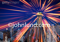 Stock photo of light rays emitting from a tall building illustrating communications, connection, technology and the future.