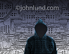A faceless hooded figure lurks within a complex network of computer circuitry and binary numbers in a cyber criminal and computer hacking stock photo.