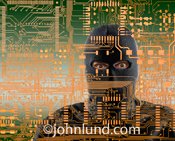A computer hacker peers out from the circuitry of a computer mother board in a photo illustrating cyber crime and Internet threats.