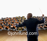 An African American Conductor orchestrates or leads a network of computers in a photo symbolizing connection, networking, teamwork and communication. Pictures showing teamwork.