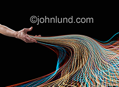 Networking and connections are superbly illustrated in this stock photo of a stream of colored light trails flowing forth from an out stretched hand.