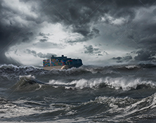 A container ship navigates rough seas in an ocean storm in this stock photo about transportation, shipping, and conquering adversity.
