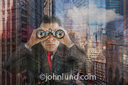 Corporate espionage and computer hacking are the primary concepts behind this photo of a businessman using binoculars in an urban high rise background and with a business meeting reflected in the lenses.