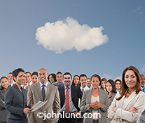 A large crowd has gathered under a single cloud in a stock photo that concepts such as cloud computing, crowd sourcing, teamwork and connections.