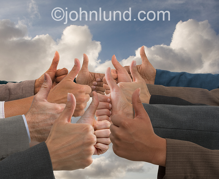 "A group, or crowd, of hands point their thumbs up in an unmistakable display of approval in an image that can apply to online reviews, social media and ""tribes"" and ""communities""."