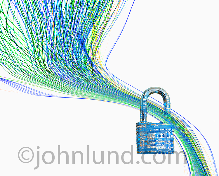 Cyber security is the unmistakable topic of this stock photo showing colored lines of light, representing data transmission, funneling through a padlock, which represents security.