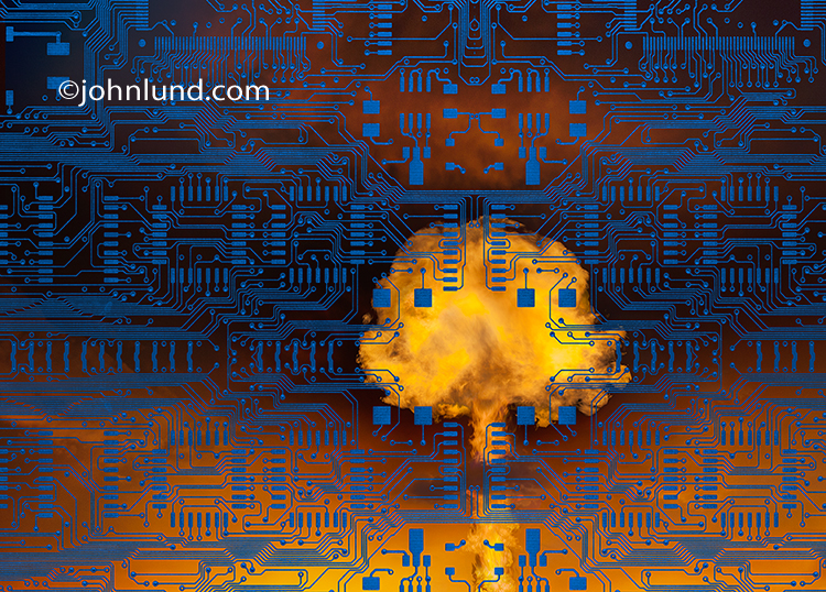 A cyber terrosim mushroom shaped fireball erupts from behind computer circuitry in this photo illustrating hackers, state-sponsored-Internet attacks, and cyber warfare.