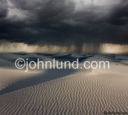 Stock picture of a rain storm rolling over the desert symbolic of hope, possibilities, wishes fulfilled and hope. Picture of a rain storm in the desert.