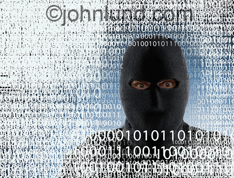 A computer hacker cyber criminal is portrayed in a ski mask amid layers of binary numbers in a dramatic stock photo about the dangers and risks of online communications.
