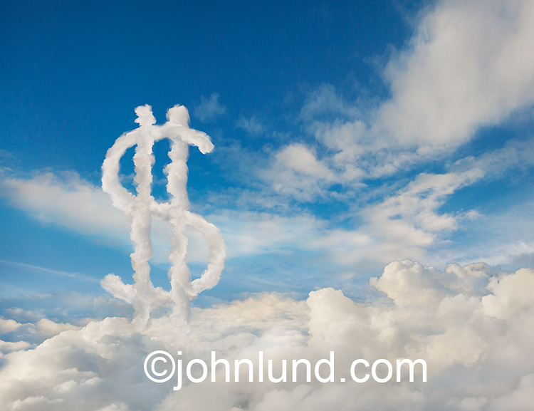 "Clouds form a dollar sign to indicate financial and businiess opportunities as well as success available through Internet connections in ""the cloud""."