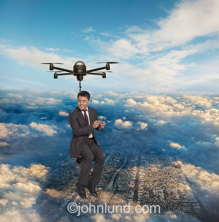 A business man commutes by drone high over Los Angeles in this humorous stock photo about the drones, the future, and new technology.