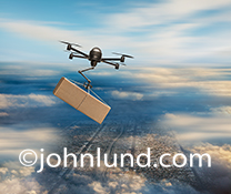 Drone Pictures - Flying drone making a rush delivery in the sky above a city far below. A drone zooms through the sky at high speed carrying a package in a stock photo about drones, freight, and future technology. The drone is above the clouds.